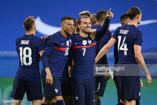 France's forward Antoine Griezmann celebrates with France's forward Kylian Mbappe after scoring his team's second goal during the friendly football...