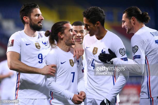 France's forward Antoine Griezmann celebrates with teammates after scoring a goal during the FIFA World Cup Qatar 2022 qualification Group D football...
