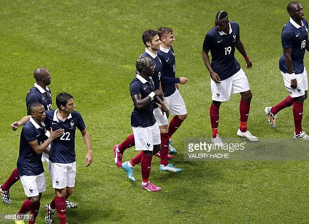 France's forward Antoine Griezmann celebrates with teammates after scoring a goal during the international friendly football match France vs Paraguay...