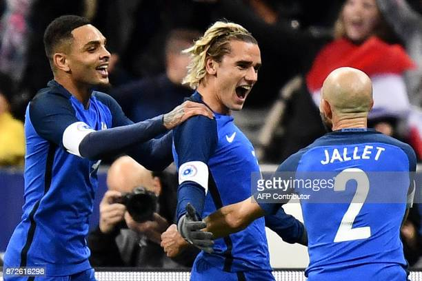 France's forward Antoine Griezmann celebrates with teammates after scoring a goal during the friendly football match between France and Wales at the...