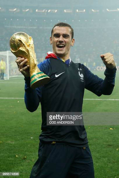 France's forward Antoine Griezmann celebrates with the World Cup trophy after the Russia 2018 World Cup final football match between France and...