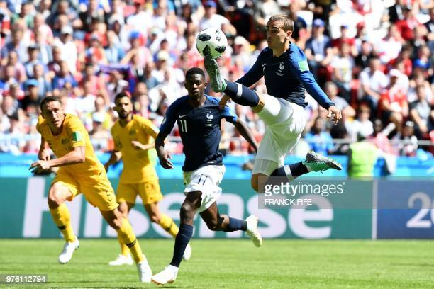 TOPSHOT France's forward Antoine Griezmann controls the ball beside France's forward Ousmane Dembele during the Russia 2018 World Cup Group C...