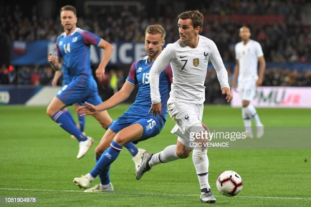 France's forward Antoine Griezmann controls the ball during the friendly football match between France and Iceland at the Roudourou Stadium in...