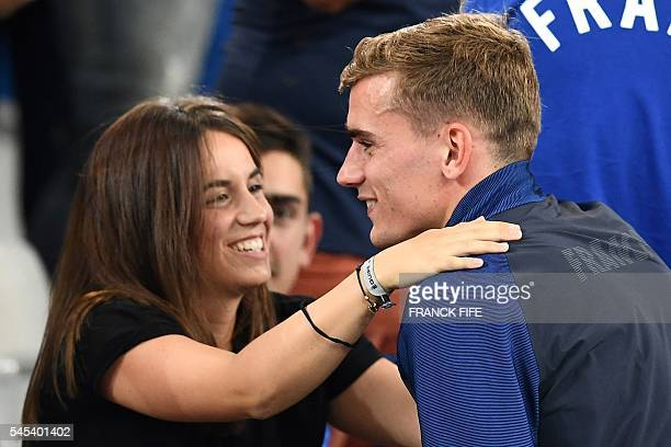 France's forward Antoine Griezmann hugs his girlfriend Erika Choperena as he celebrates the team's 20 win over Germany in the Euro 2016 semifinal...
