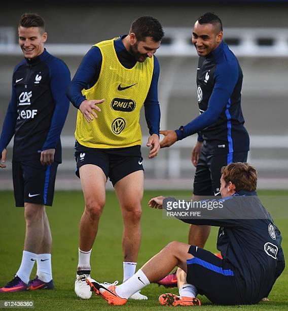 France's forward Antoine Griezmann jokes with France's forward AndrePierre Gignac next to France's defender Lucas Digne and France's forward Dimitri...