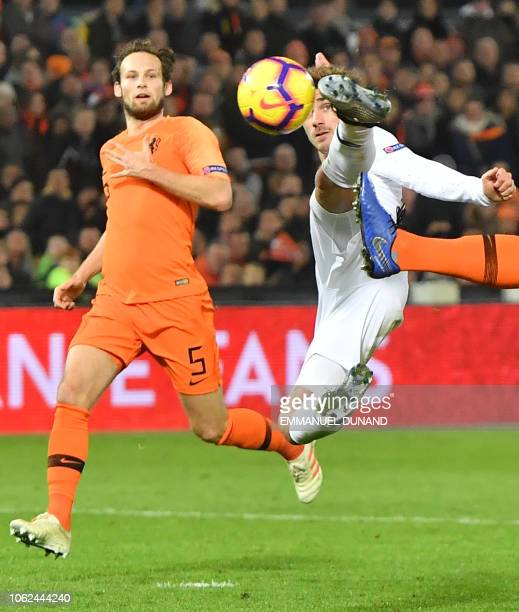 France's forward Antoine Griezmann jumps for the ball during the UEFA Nations League football match between the Netherlands and France at the...