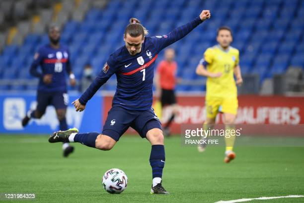 France's forward Antoine Griezmann kicks the ball during the FIFA World Cup Qatar 2022 qualification Group D football match between Kazakhstan and...