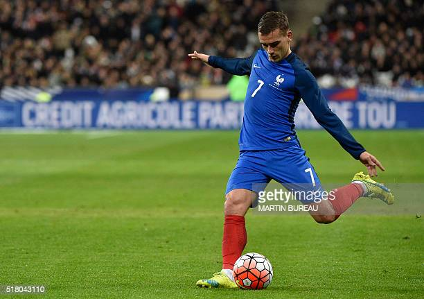 France's forward Antoine Griezmann kicks the ball during the international friendly football match between France and Russia at the Stade de France...