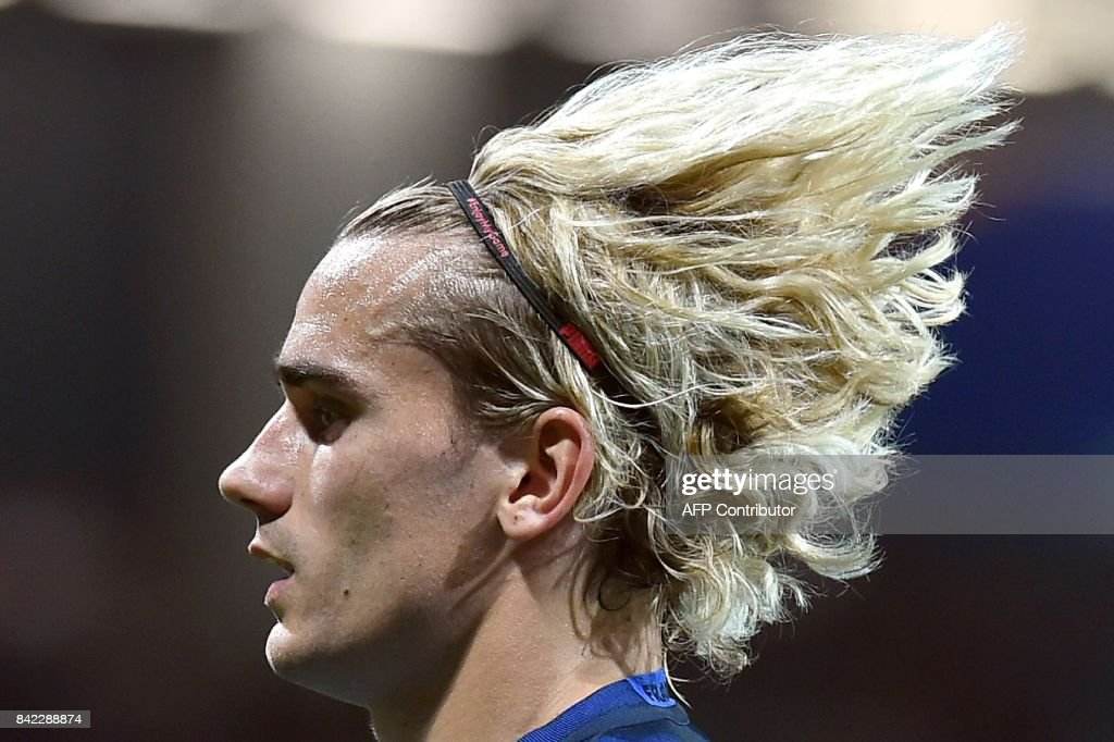 TOPSHOT - France's forward Antoine Griezmann looks on during the FIFA World Cup 2018 qualifying football match France vs Luxembourg on September 3, 2017 at the Municipal Stadium in Toulouse, southern France. /