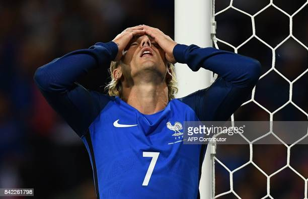 France's forward Antoine Griezmann reacts after missing a shot during the FIFA World Cup 2018 qualifying football match France vs Luxembourg on...