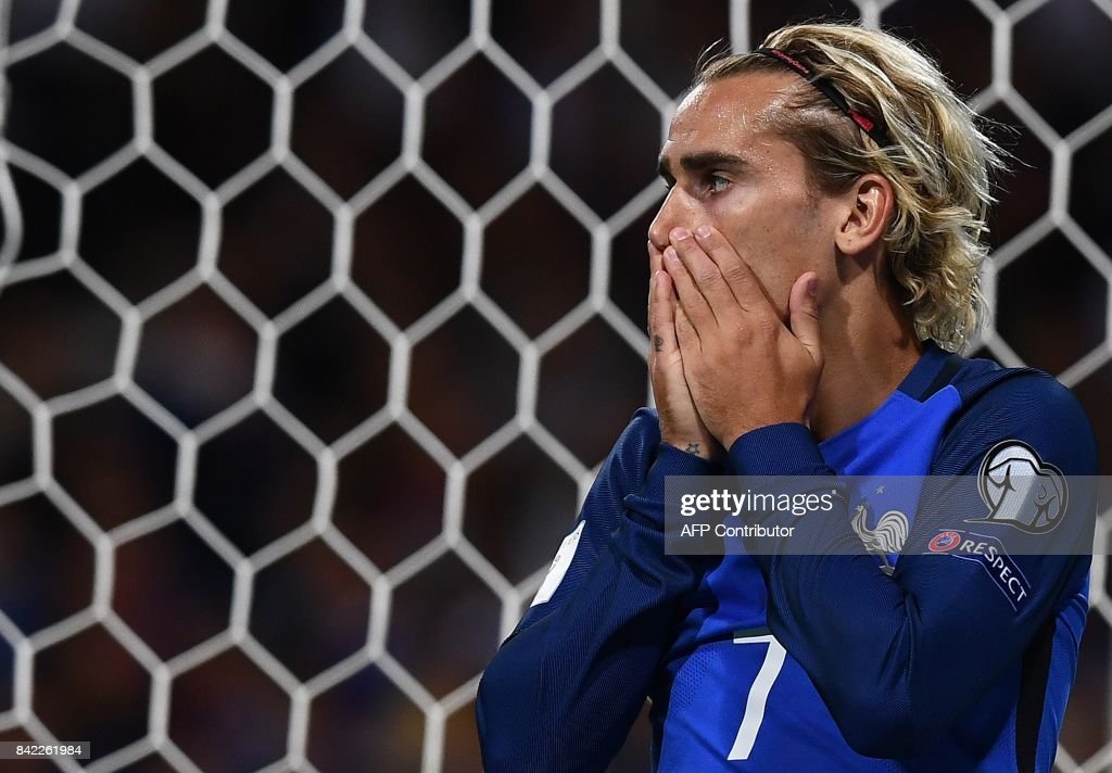 France's forward Antoine Griezmann reacts after missing a shot during the FIFA World Cup 2018 qualifying football match France vs Luxembourg on September 3, 2017 at the Municipal Stadium in Toulouse, southern France. /