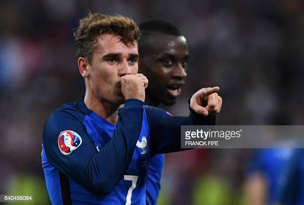 France's forward Antoine Griezmann reacts after scoring a goal during the Euro 2016 group A football match between France and Albania at the...