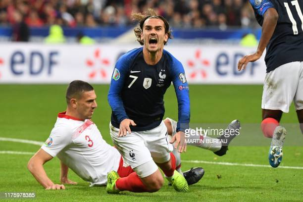 TOPSHOT France's forward Antoine Griezmann reacts to a tackle of Turkey's defender Merih Demiral during the Euro 2020 Group H qualification football...