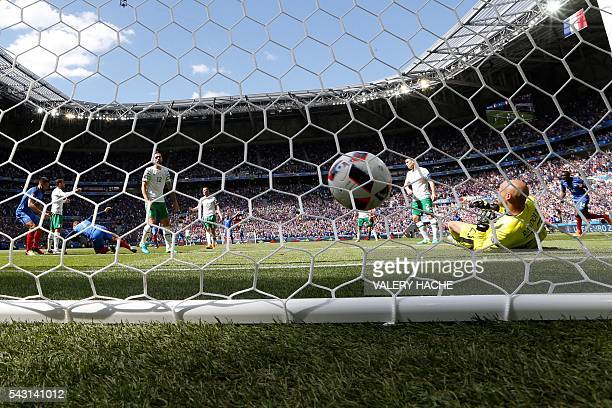 France's forward Antoine Griezmann scores a first goal past Ireland's goalkeeper Darren Randolph during the Euro 2016 round of 16 football match...