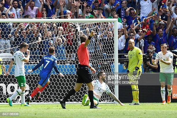 France's forward Antoine Griezmann scores a goal during the Euro 2016 round of 16 football match between France and Republic of Ireland at the Parc...