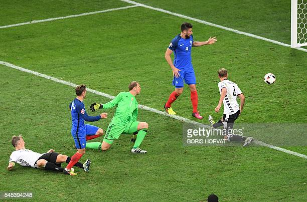 TOPSHOT France's forward Antoine Griezmann scores a goal past Germany's goalkeeper Manuel Neuer during the Euro 2016 semifinal football match between...