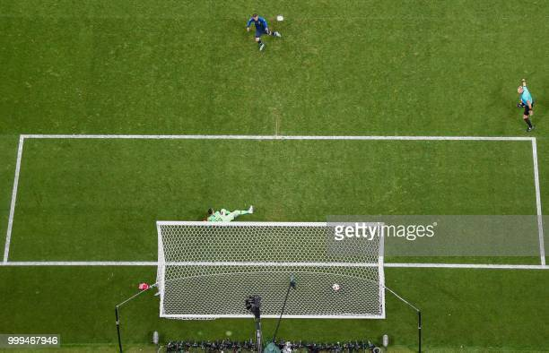 France's forward Antoine Griezmann scores a penalty kick during the Russia 2018 World Cup final football match between France and Croatia at the...