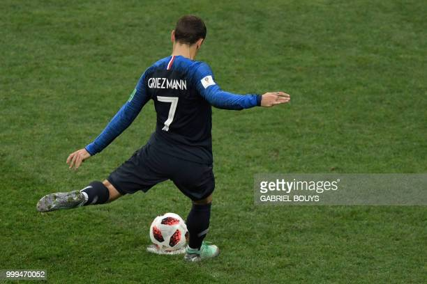TOPSHOT France's forward Antoine Griezmann shoots a penalty kick and scores during the Russia 2018 World Cup final football match between France and...