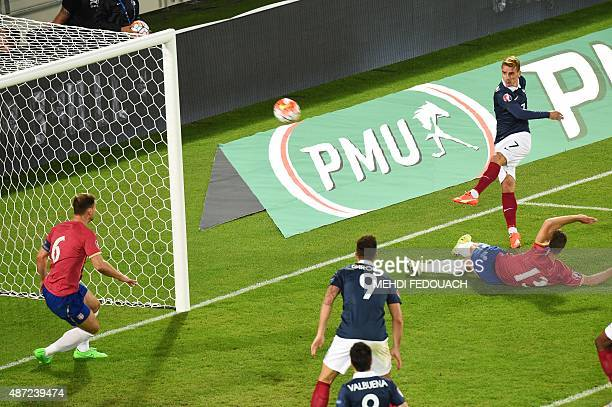 France's forward Antoine Griezmann shoots the ball during the Euro 2016 friendly football match France vs Serbia at the Matmut Atlantique stadium in...