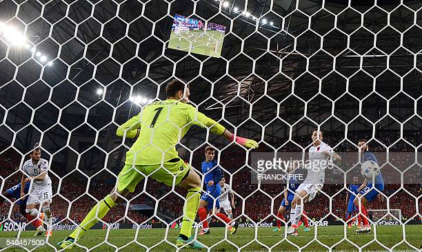 France's forward Antoine Griezmann shoots to score France's first goal during the Euro 2016 group A football match between France and Albania at the...