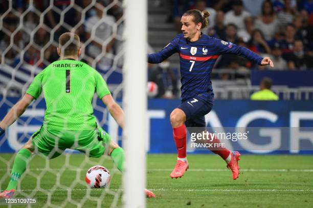 France's forward Antoine Griezmann shoots to score his team's second goal during the FIFA World Cup Qatar 2022 Group D qualification football match...