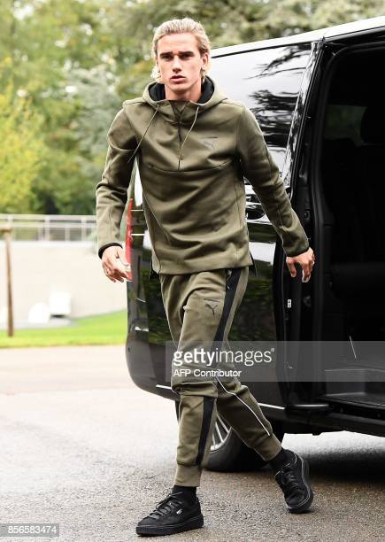 France's forward Antoine Griezmann steps out of a vehicle as he arrives in Clairefontaine en Yvelines on October 2 as part of the team's preparation...