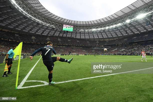 France's forward Antoine Griezmann takes a corner kick during the Russia 2018 World Cup final football match between France and Croatia at the...