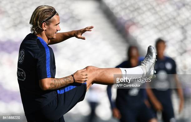 France's forward Antoine Griezmann takes part in a training session at the Municipal Stadium in Toulouse southern France on September 2 on the eve of...