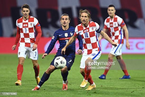 France's forward Antoine Griezmann vies for the ball with Croatia's midfielder Luka Modric during the UEFA Nations League Group A3 football match...