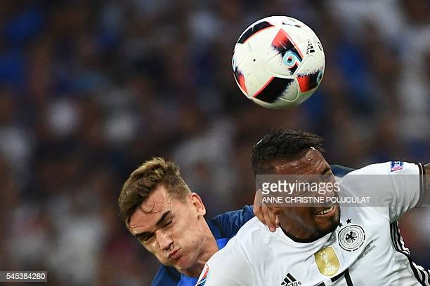 France's forward Antoine Griezmann vies for the ball with Germany's defender Jerome Boateng during the Euro 2016 semifinal football match between...