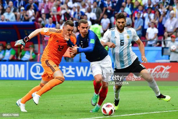 France's forward Antoine Griezmann vies with Argentina's goalkeeper Franco Armani and Argentina's defender Federico Fazio during the Russia 2018...
