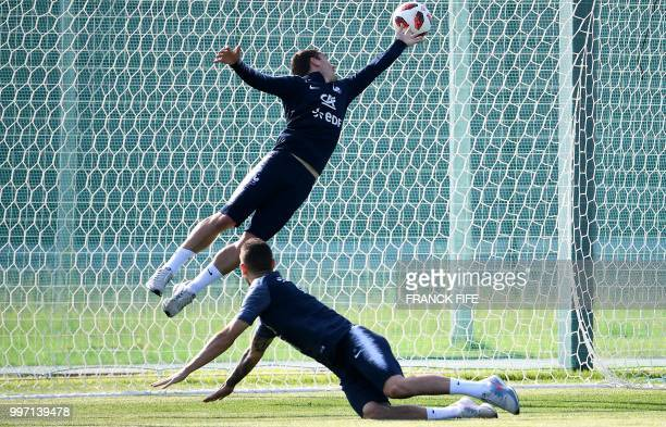 TOPSHOT France's forward Antoine Griezmann vies with France's defender Lucas Hernandez during a training session at the Glebovets stadium in Istra...