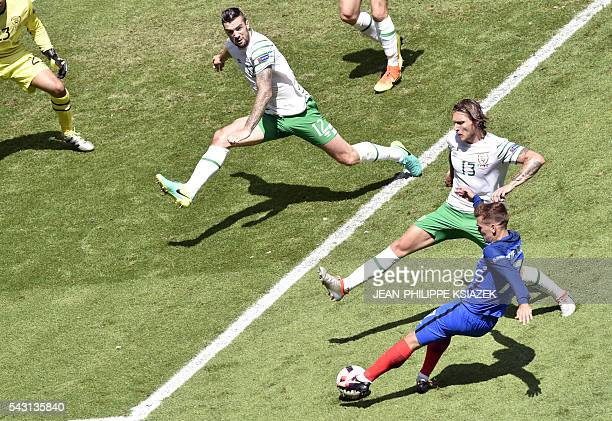 France's forward Antoine Griezmann vies with Ireland's players during the Euro 2016 round of 16 football match between France and Republic of Ireland...