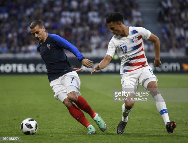 France's forward Antoine Griezmann vies with USA's defender Antonee Robinson during the friendly football match between France and USA at the at the...