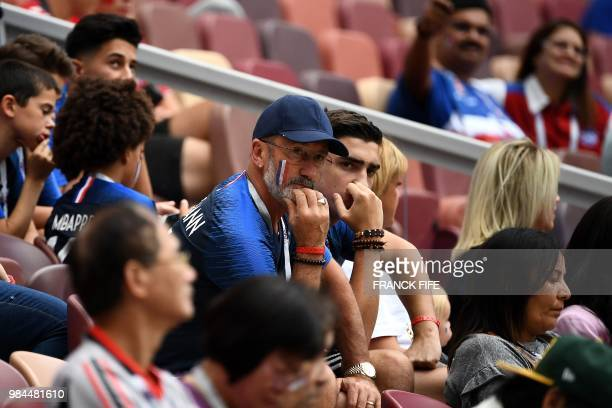 France's forward Antoine Griezmann's father Alain and his brother Theo are pictured in the stands before the Russia 2018 World Cup Group C football...