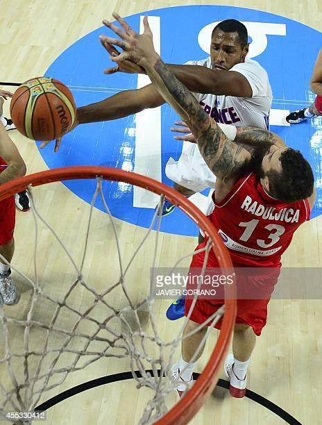 France's forward Boris Diaw vies with Serbia's centre Miroslav Raduljica during the 2014 FIBA World basketball championships semifinal match France...