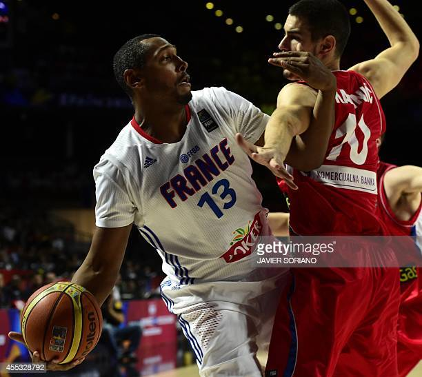France's forward Boris Diaw vies with Serbia's forward Nikola Kalinic during the 2014 FIBA World basketball championships semifinal match France vs...