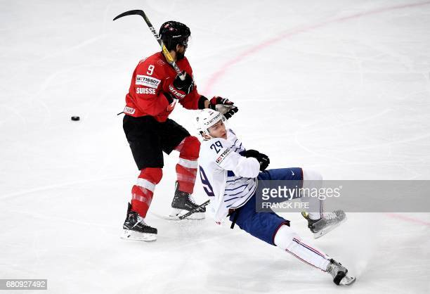 France's forward Damien Fleury falls during the IIHF Men's World Championship group B ice hockey match between Switzerland and France, on May 9 in...