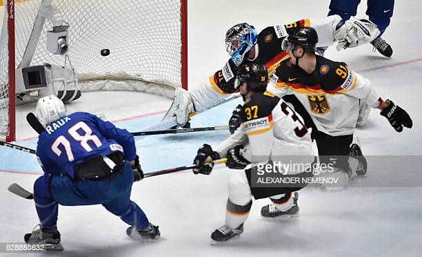 France's forward Damien Raux scores during the group B preliminary round game France vs Germany at the 2016 IIHF Ice Hockey World Championship in St...