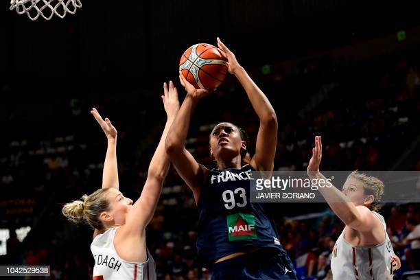 France's forward Diandra Tchatchouang vies with Belgium's forward Antonia Delaere and Belgium' center Kyara Linskens during the FIBA 2018 Women's...