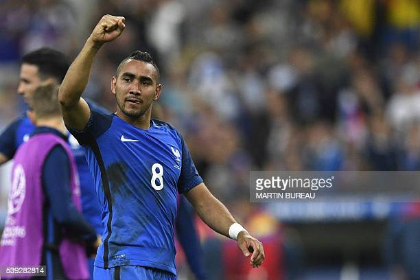 France's forward Dimitri Payet acknowledges the fans after France beat Romania 2-1 in the opening match of the Euro 2016 group A football match...