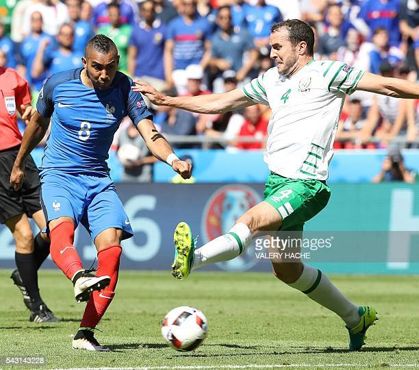 France's forward Dimitri Payet and Ireland's defender John O'Shea vie for the ball during the Euro 2016 round of 16 football match between France and...