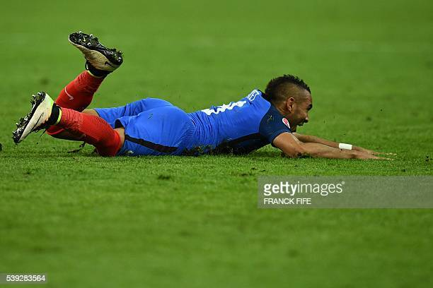 France's forward Dimitri Payet celebrates after scoring the 2-1 during the Euro 2016 group A football match between France and Romania at Stade de...