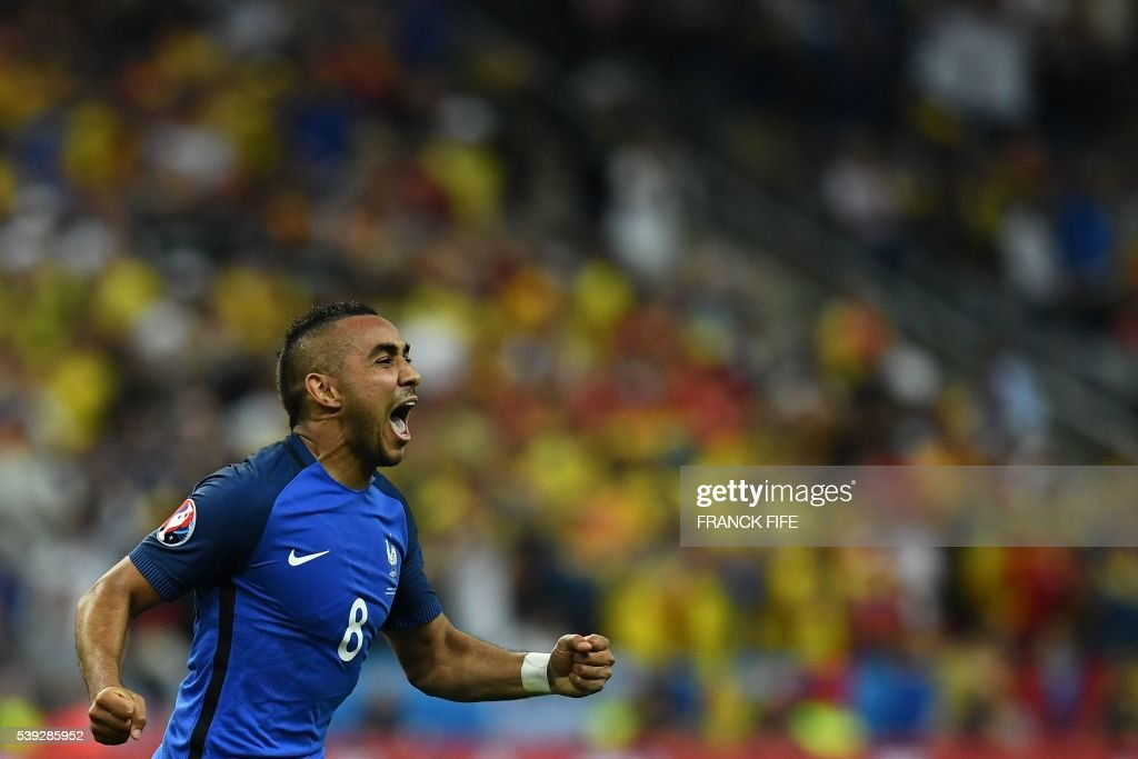 TOPSHOT - France's forward Dimitri Payet celebrates after scoring the 2-1 during the Euro 2016 group A football match between France and Romania at Stade de France, in Saint-Denis, north of Paris, on June 10, 2016. /