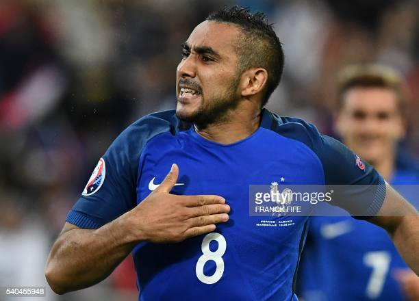 France's forward Dimitri Payet celebrates France's second goal during the Euro 2016 group A football match between France and Albania at the...