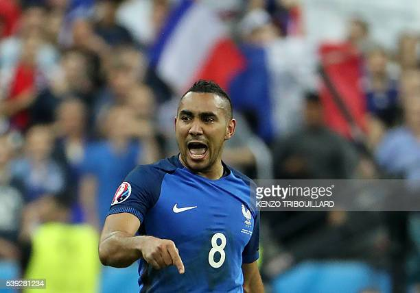 France's forward Dimitri Payet celebrates scoring France's second goal during the Euro 2016 group A football match between France and Romania at...