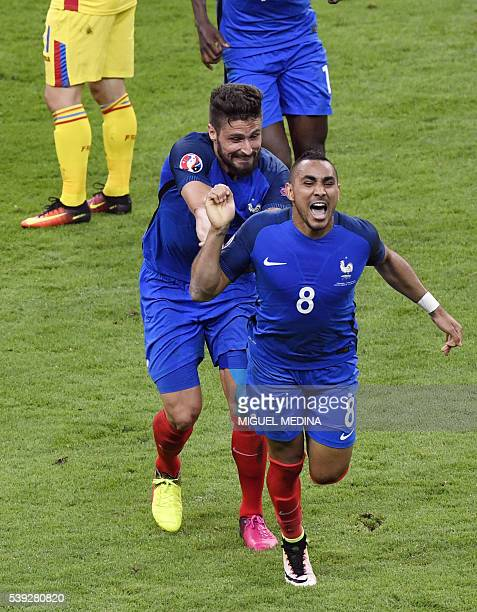 France's forward Dimitri Payet celebrates scoring the 2-1 goal with France's forward Olivier Giroud during the Euro 2016 group A football match...
