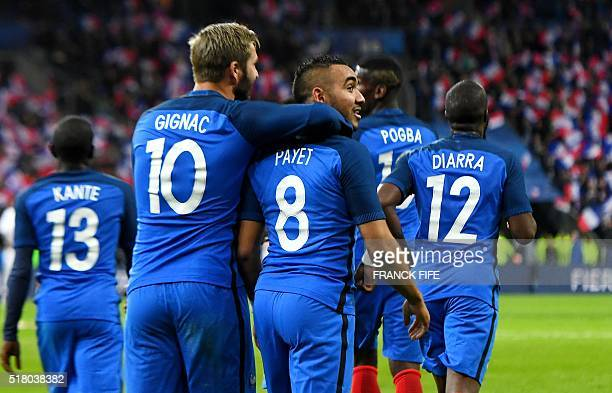 France's forward Dimitri Payet celebrates scoring the 32 with team mates during the international friendly football match between France and Russia...