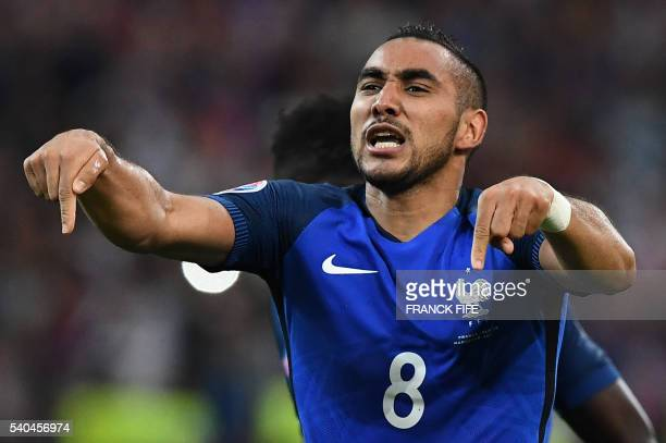 France's forward Dimitri Payet celebrates scoring the second goal during the Euro 2016 group A football match between France and Albania at the...