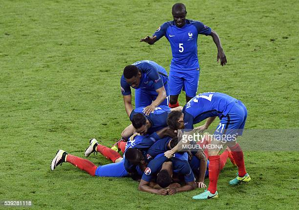 TOPSHOT France's forward Dimitri Payet celebrates with team mates after scoring the 21 goal during the Euro 2016 group A football match between...